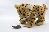 Stuffed Cheetah playing with a plastic mouse