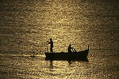 Fishermen boat sailing at sunset Alghero Sardinia Italia