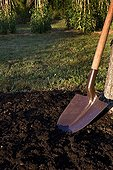 Shovel and prepared ground in a garden Provence France