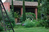 Flowered garden in front of a provencal mas