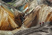 Hikers in a volcanic landscape in Iceland