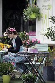 Florist in front of her shop