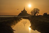 Mont Saint Michel and reflection at sunrise - France