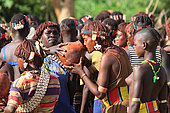 In the village of Bori, in the land of the Banas, during the initiation of the young Aïke, three welcome beers are given to the many guests over the three days. The Honey Tribe, Omo valley, Ethiopia